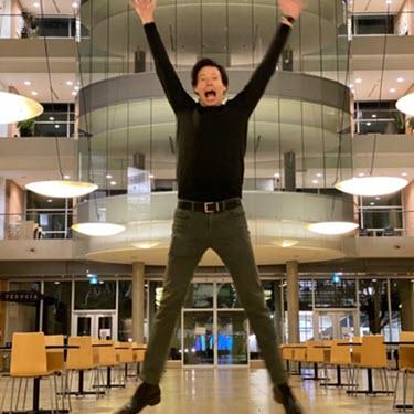 Tim Kieffer leaps in the LSI foyer